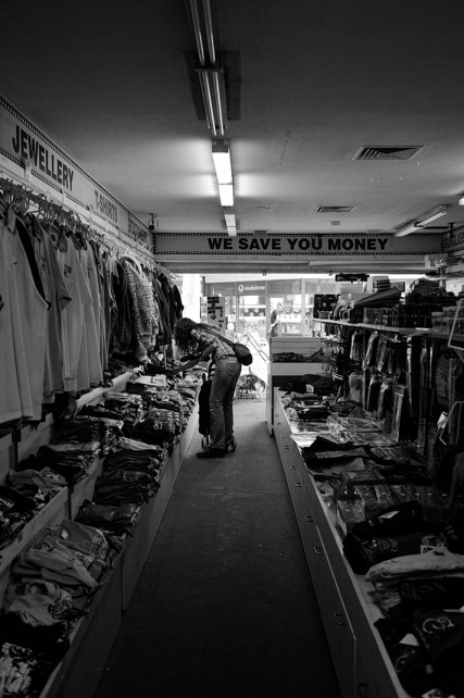 woman shopping in store black and white photo